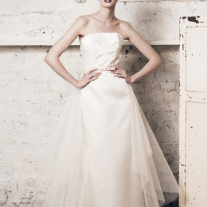 Dress by Muscat Bridal. Strapless silk duchess dress, with pencil skirt and back slit. Tulle train.