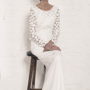 Dress by Muscat Bridal. Silk moroccain gown with puddle train. Circle embroidery top with mini peplum and scalloped edges.