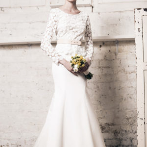 Dress by Muscat Bridal. Circle embroidery top with mini peplum and scalloped edges. Silk duchess skirt.