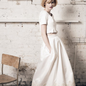 Dress by Muscat Bridal. Silk duchess crop top. Pleated skirt with corded lace applique.