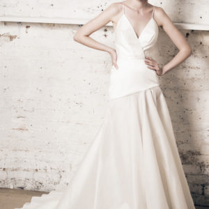 Dress by Muscat Bridal. Silk organza ball gown with plunging neckline.