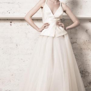 Dress by Muscat Bridal. Silk duchess wrap top with peplum. Tulle ball skirt.