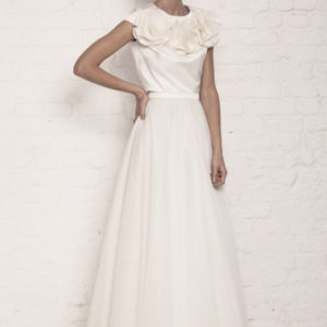 Dress by Muscat Bridal. Silk duchess top with tulle and organza flowers. Tulle ball skirt.
