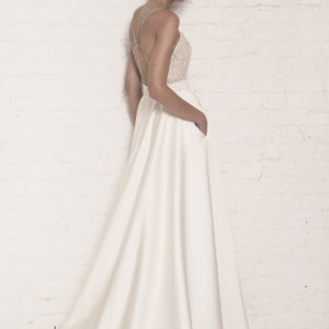 Dress by Muscat Bridal. Silk duchess backless ballgown with corded lace top.