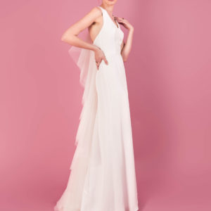 Dress by Muscat Bridal. Halter silk moroccain gown with polka dot tulle back detail.