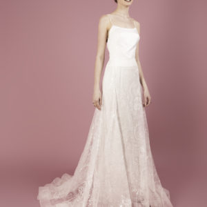 Dress by Muscat Bridal. Gown with full skirt in flower sequin tulle and fitted bodice.