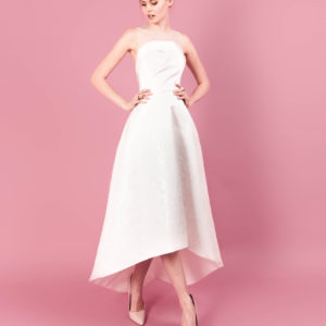 Dress by Muscat Bridal. Silk duchess dress with flower sequin tulle skirt and tulle neckline.