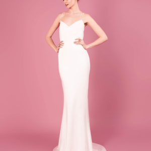 Dress by Muscat Bridal. Silk moroccain gown with pleated polka dot tulle bust detail.