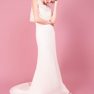 Top and skirt by Muscat Bridal. 3D flower top with scalloped edge. Structured silk organza skirt with pleated high waist.